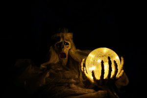 skeleton looking at crystal ball