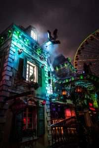 haunted house at carnival with ferris wheel in the background