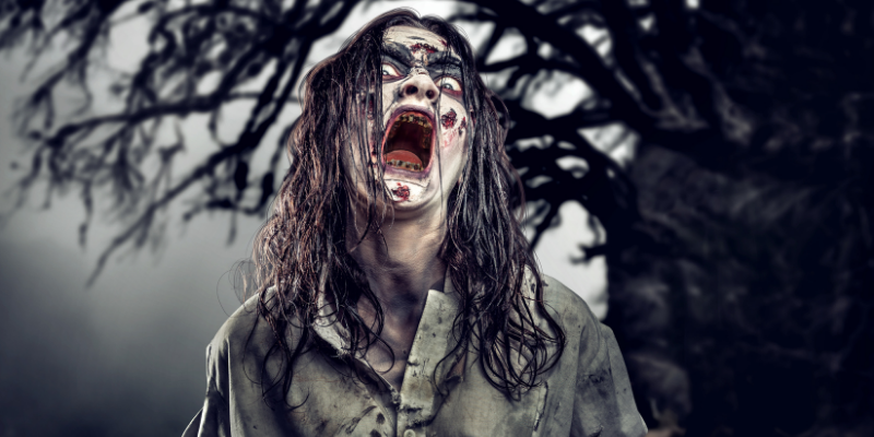 zombie woman with long hair snarling at the camera