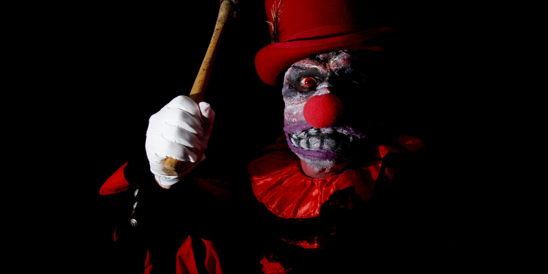 scary clown holding a bat