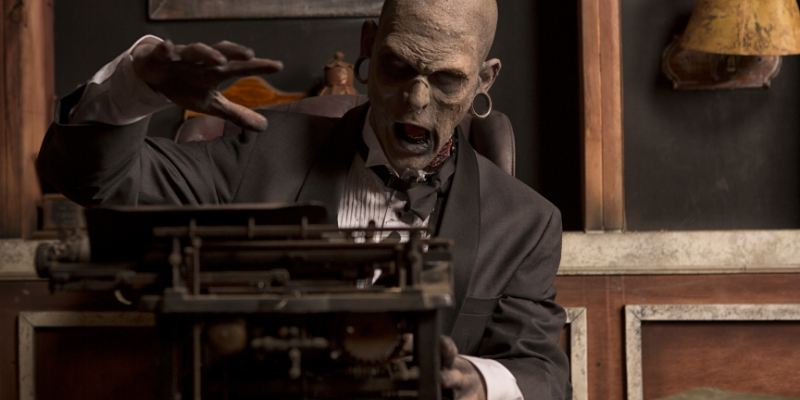 zombie in office using old typewriter