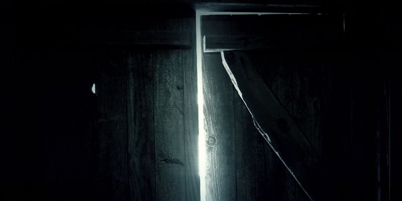 creepy door opening with light shining through