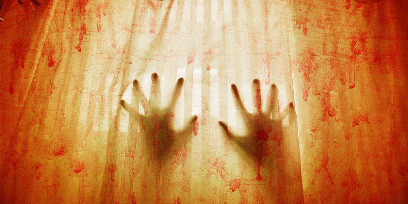 hands pushing against a bloody screen